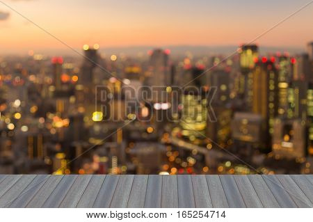 Opening wooden floor blurred lights Osaka city business downtown abstract background