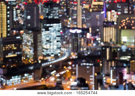 Blurred bokeh lights Osaka city business building abstract background