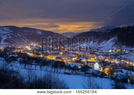 Winter landscape of Bran mountain resort, at blue hour