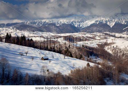 Winter mountains landscape in the transylvanian village