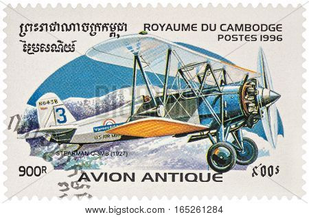 MOSCOW RUSSIA - January 10 2017: A stamp printed in Cambodia shows American cargo aircraft Stearman C-3MB (1927) for the transport of mail series Biplanes