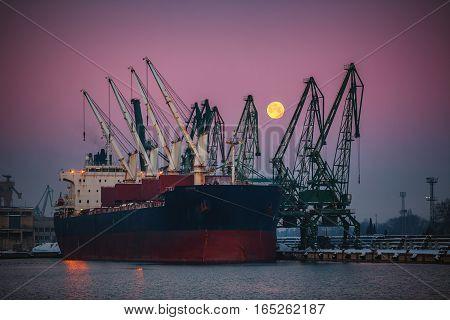 Cargo ship docked in the port morning shot