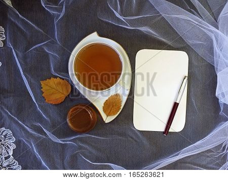 Cup of tea and sheet of paper