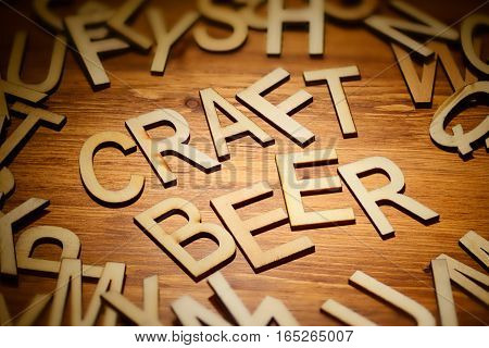 Words craft beer written hand made style letters type on a dark wooden background