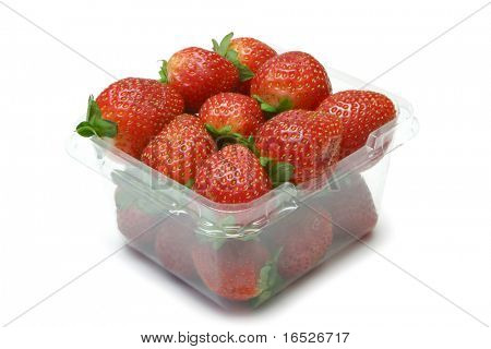 Clear plastic tub or punnet of fresh strawberries isolated on white