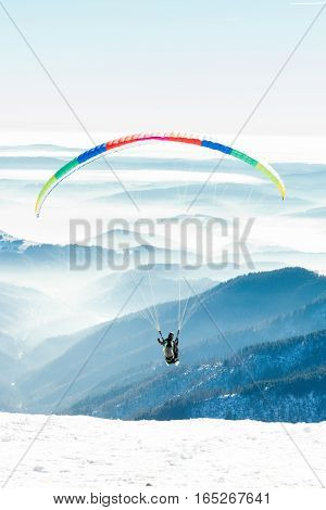 Paraglider Launched Into Air From A Mountain Peak
