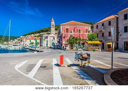 View at mediterranean travel place Pucisca on Island brac, famous historic stonemason destination in Croatia, Europe.