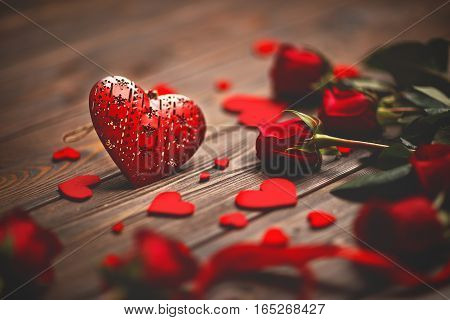 Background Valentine's Day. heart and roses on a wooden background