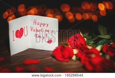 Background Valentine's Day. card heart and roses on a wooden background