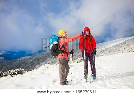 Two Girls In The Mountains In Winter.