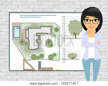 Young girl landscape designer, working on a project. A professional in the business. Drawing board with design project. Confident girl