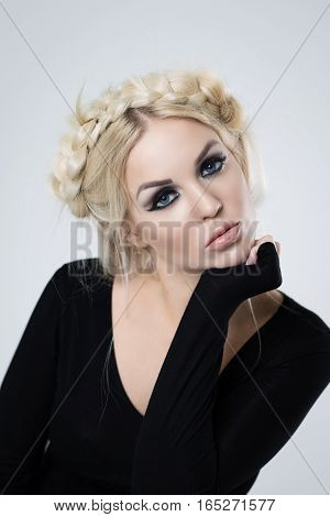 portrait of blond with makeup on a white background in studio