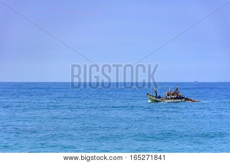 Fishing boat sailing in the waters of the Rio de Janeiro sea