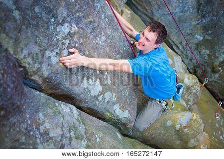 The Climber Climbs The Rock.