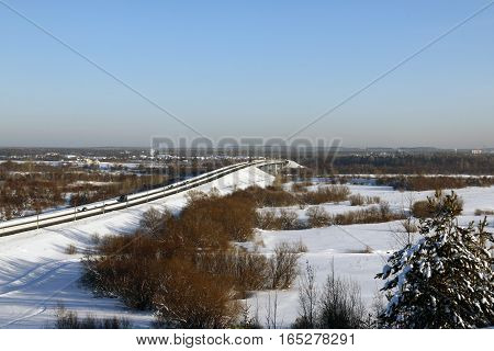 Snowy Field And The Bridge In A Winter Day