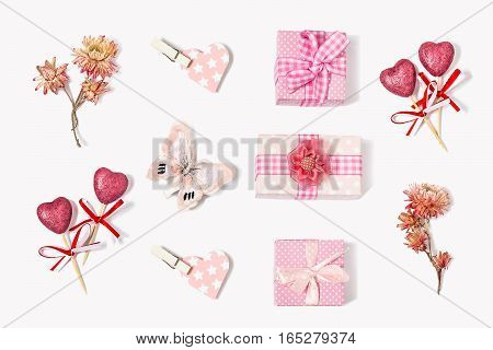Composition to Valentines Day: gift boxes with bows butterfly flowers little hearts. All gifts pink. The mood of love and tenderness. Flat lay top view