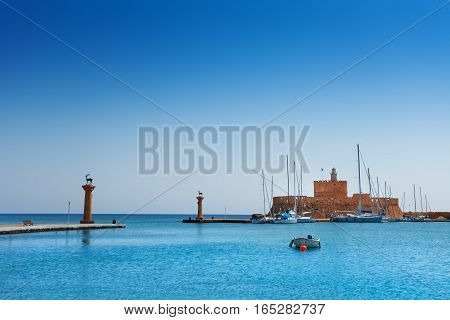 Mandraki Harbor with the fortress of St. Nicholas on the background, Rhodes island, Europe
