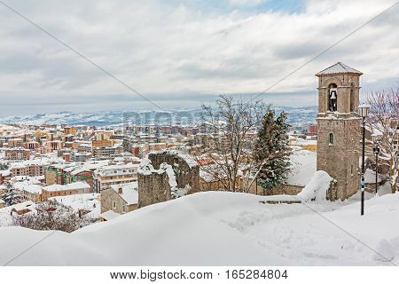 a snowy urban landscape with church of Campobasso