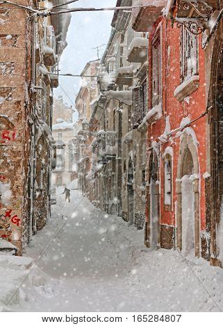 a italian snowy alley in old village