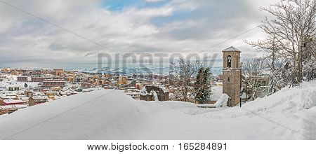 the snowy panorama with church of Campobasso