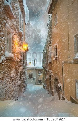 the snowy city street in the dusk