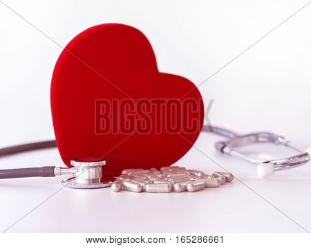 Red Heart, Pills  And Stethoscope On White Background. Health Care Concept.
