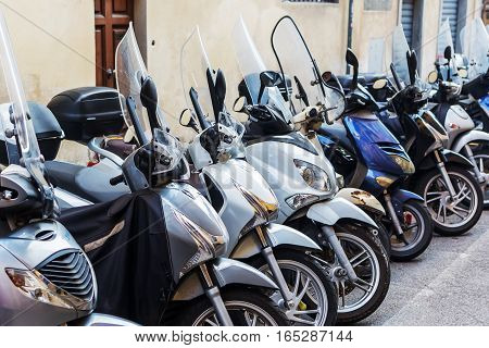 Row Of Scooters Parked Roadside