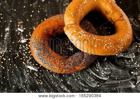 Bagel on a dark background. Bakery products.