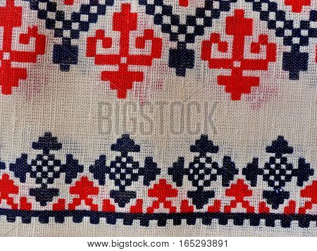 Fabric texture background / Fabric texture. White flax  tablecloth with a pattern. Closeup. Russian folk craft