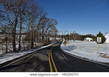 Winter season with snow on country road in North Georgia