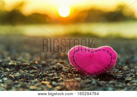Valentine's Day. knitted hearts. pink heart and sunset