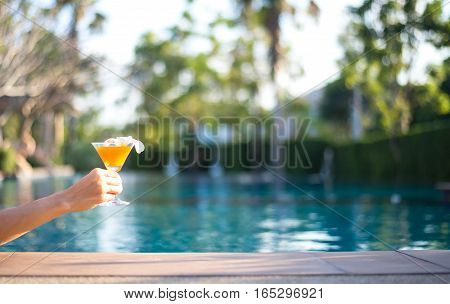 Tasty cocktail background swimming pool, relax and happy time