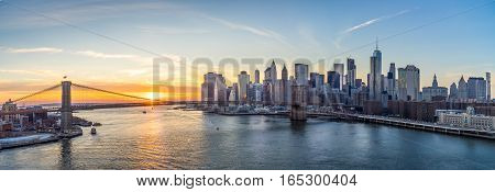 Over looking Manhattan skyline and brooklyn bridge with sunset