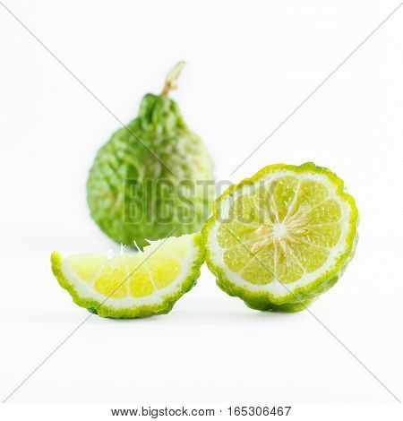 Green rough peel bergamot fruit or kaffir lime isolated on white background