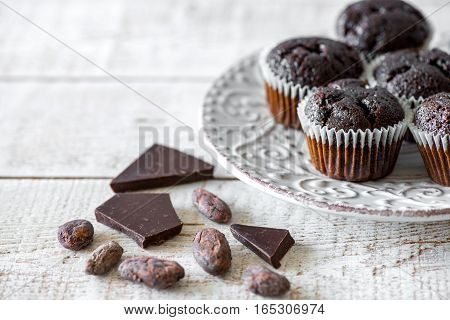 Chocolate muffins on a white rustic wooden table - selective focus copy space