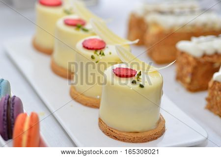 Tray with delicious cakes and macaroon .