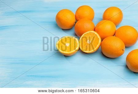Oranges on a blue wooden background. Healthy food concept