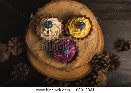 Cupcakes. Colorful cupcakes. Cupcakes on the wooden background