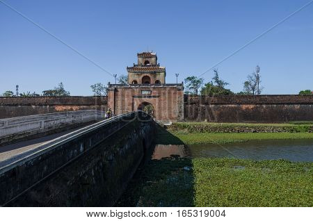 Hue, Vietnam- January 5, 2015: The gate in to citadel (emperors palace) and bridge over Imperial Palace moat HueVietnam