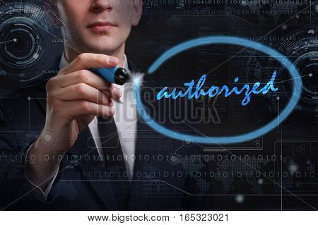 Business, Technology, Internet And Network Concept. Young Business Man Writing Word: Authorized