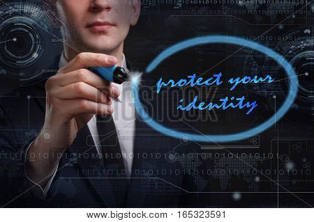 Business, Technology, Internet And Network Concept. Young Business Man Writing Word: Protect Your Id