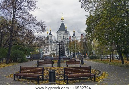 View of Church of St. Michael the Archangel from the park. Moscow Russia. Cloudy day in mid-October.