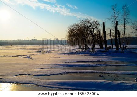 the beautiful landscape of the lake is covered with ice in the center of the city