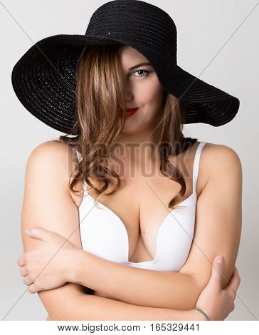 beautiful girl in broad-brimmed hat posing and expresses different emotions. headache, sadness, fatigue.
