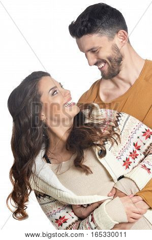 young couple in love, smiling and posing