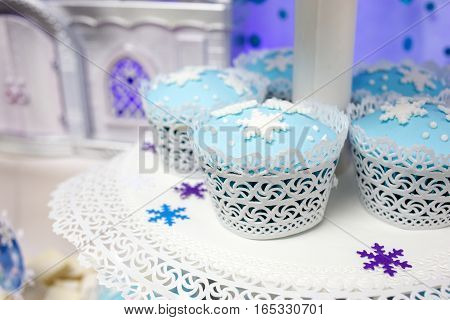Cakes of blue color with snowflakes issued in winter style. Selective focus