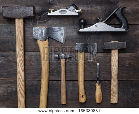 assorted tools for carpenter on wood background