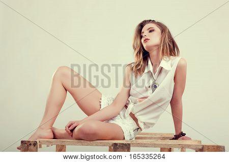 Beautiful Girl Posing In Studio In Fashion Style
