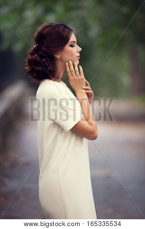 Woman Posing In Park On Green Natural Background