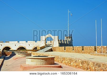 CHANIA, CRETE - SEPTEMBER 16, 2016 - View over the Maritime Museum rooftop towards the watchtower Chania Crete Greece Europe, September 16, 2016.